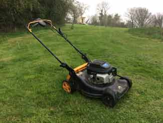 mowing tall grass